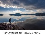 photographer is shooting clouds ... | Shutterstock . vector #563267542