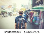 young asian traveling... | Shutterstock . vector #563283976