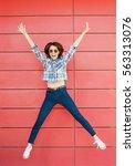 joyful happy young woman... | Shutterstock . vector #563313076