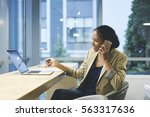 smiling female executive happy... | Shutterstock . vector #563317636