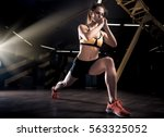 sportive young woman in a gym... | Shutterstock . vector #563325052