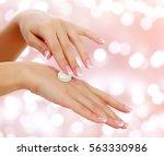 woman hands with a cream on an...   Shutterstock . vector #563330986