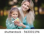 cute little girl with mother... | Shutterstock . vector #563331196