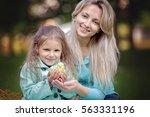 cute little girl with mother... | Shutterstock . vector #563331196