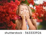 allergy. little girl is blowing ... | Shutterstock . vector #563333926