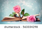 Pink Roses On An Old Book With...