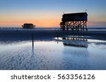 Stilt House And Jetty On The...