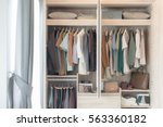colorful clothes hanging on... | Shutterstock . vector #563360182