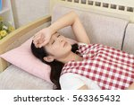tired asian housewife | Shutterstock . vector #563365432