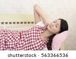 tired asian housewife | Shutterstock . vector #563366536