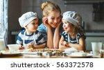 happy family in the kitchen.... | Shutterstock . vector #563372578