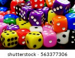 closeup of pile of dice for... | Shutterstock . vector #563377306