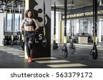 slim sportive woman with curly... | Shutterstock . vector #563379172