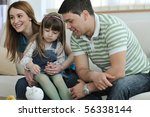 young parents at home with... | Shutterstock . vector #56338144