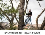 lumberjack with saw and harness ... | Shutterstock . vector #563454205