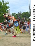 Small photo of Ohsweken, Ontario, Canada - July 24, 2016 : Six Nations of the Grand River Pow Wow. Turtle Island. Grass Dancers, Fancy Feather Dancers Powwow Native American in their traditional regalia.
