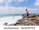 girl ocean rocky coastline... | Shutterstock . vector #563459752