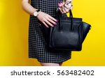 close up of black leather bag... | Shutterstock . vector #563482402
