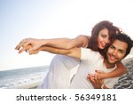 young couple at the beach posing | Shutterstock . vector #56349181