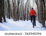 mountain biker riding bike on... | Shutterstock . vector #563540296