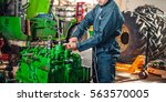 mechanic repairing disassembled ... | Shutterstock . vector #563570005
