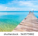 contemplating the sea jetty to... | Shutterstock . vector #563575882