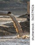 Small photo of industrial effluent, pipeline discharging liquid industrial waste into a river
