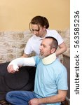 an therapist helps a injured... | Shutterstock . vector #563585236