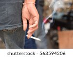 Image Of Cigarette In Man Hand...