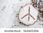peace sign in the snow | Shutterstock . vector #563602306