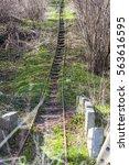 old railway road   not in use. | Shutterstock . vector #563616595