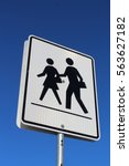 crosswalk sign against blue sky | Shutterstock . vector #563627182
