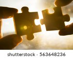 two hands trying to connect... | Shutterstock . vector #563648236