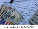 us tax form  dollar cash  pen ... | Shutterstock . vector #563664835