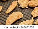 grilling chicken on the stove... | Shutterstock . vector #563671252