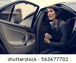 businesswoman corporate taxi... | Shutterstock . vector #563677702