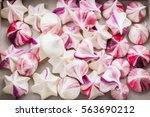 Small photo of Homemade rainbow meringue kisses drops romantic pink
