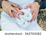 pregnant woman and father... | Shutterstock . vector #563704282