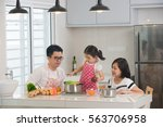 asian family cooking at kitchen | Shutterstock . vector #563706958