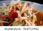 salad  made from papaya  cut... | Shutterstock . vector #563711962