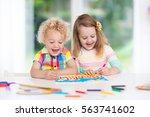 little boy and girl draw... | Shutterstock . vector #563741602