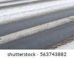 road getting covered in snow. | Shutterstock . vector #563743882