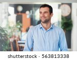 handsome entrepreneur thinking... | Shutterstock . vector #563813338