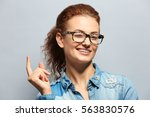 young woman with spectacles on... | Shutterstock . vector #563830576