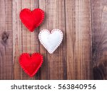 three hearts out of felt on a... | Shutterstock . vector #563840956