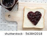 toast with jam in shape of... | Shutterstock . vector #563842018