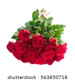 Stock photo pile of fresh dark red rose buds with green leaves isolated on white background 563850718