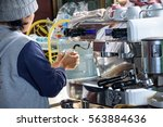 woman making coffee with coffee ... | Shutterstock . vector #563884636