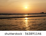 Sunset And Little Wave