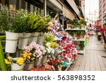 many flowers in the market.... | Shutterstock . vector #563898352